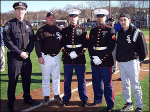 "Boston Police Chief Kelley McCormick, John ""Smokey"" Moore, Toys for Tots representatives from the U.S. Marine Corps and Brett Rudy."